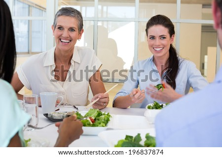 Business people enjoy healthy lunch in the office - stock photo