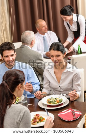 Business people enjoy lunch at the restaurant management discussion