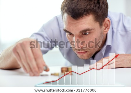 business, people, finances, statistics and money saving concept - businessman putting coins into piles and growing chart - stock photo