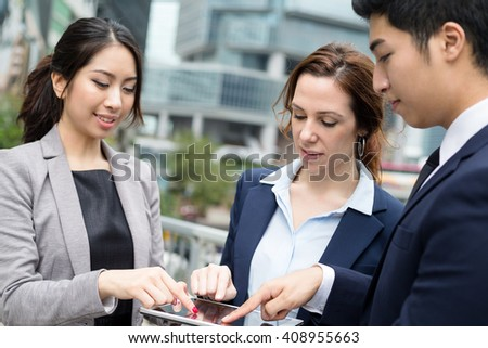 Business people finger touch on digital tablet