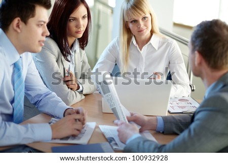 Business people gathered to discuss some urgent matters - stock photo