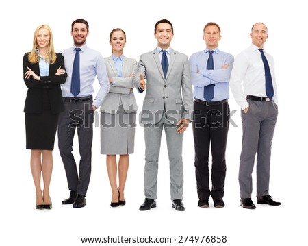business, people, gesture and partnership concept - group of smiling businessmen making handshake - stock photo