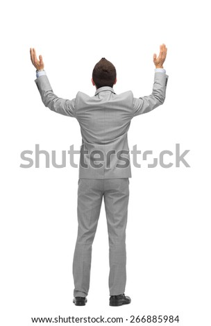 business, people, gesture, success and office concept - businessman raising hands up from back - stock photo