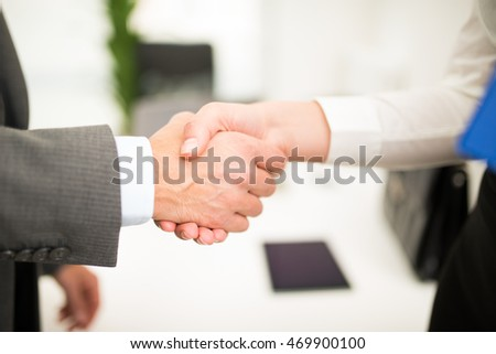 Business people giving an handshake