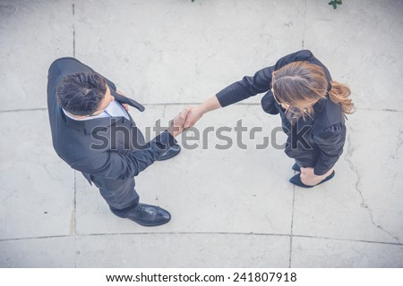 Business People Giving Handshake, Aerial View - stock photo