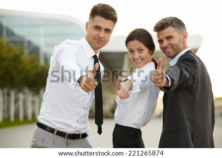 Business people giving thumbs up. Business Team