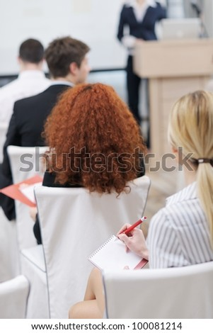 business people group at meeting seminar presentation in brigt conference room - stock photo