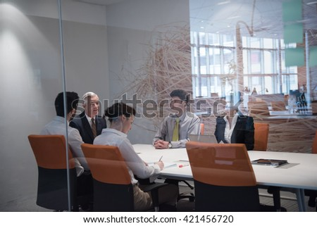 business people group brainstorming on meeting and businessman presenting ideas and projects oon laptop and tablet computer - stock photo