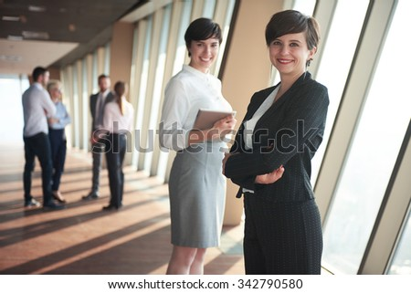 business people group,  females as team leaders standing together  in modern bright office interior - stock photo