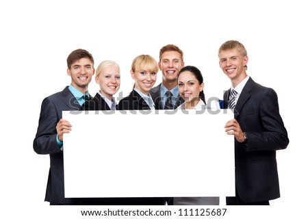 Business people group holding a blank white card board, signboard, showing an empty bill board, young businesspeople standing together happy smile, portrait Isolated over white background