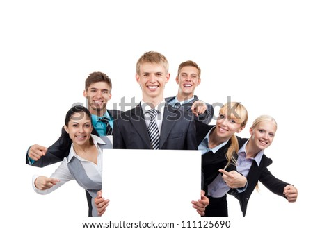 Business people group holding blank white card board, signboard, point finger showing an empty bill board, young businesspeople standing together happy smile, portrait Isolated over white background - stock photo