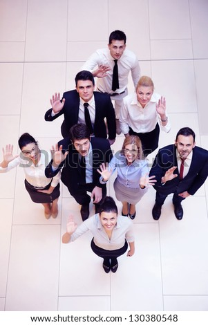 business people group joining hands and stay as team in circle  and representing concept of friendship and teamwork - stock photo