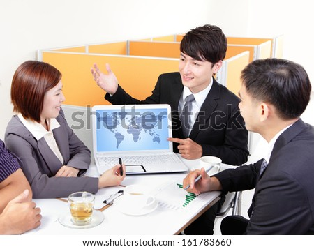 business people group meeting with finger point world map in computer screen at office, asian people - stock photo