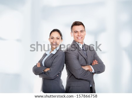 Business people group team standing folded hand smile, businessman and businesswoman wear gray suit over abstract office background