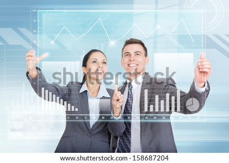Business people group team working with virtual touch screens smile, businessman and businesswoman touch information graph wear gray suit over abstract blue background, concept of technology interface - stock photo