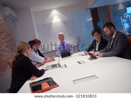 business people group with young adults and senior on meeting at modern bright office interior.