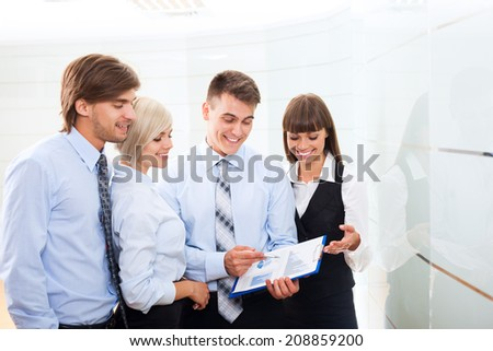 business people group working looking to paper documents at office, discussion on meeting, happy group businesspeople smile holding clipboards, team cooperation, communicate at conference hall