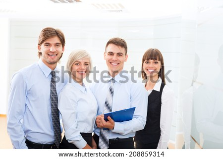 business people group working looking to paper documents at office, discussion on meeting, happy group businesspeople smile holding clipboards, team cooperation, communicate at conference hall - stock photo