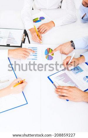 business people hands analyst team work group during conference discussing financial business charts, businesspeople accounting meeting sitting at desk office point finger at graph document