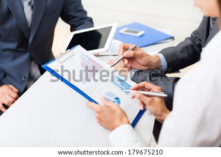 business people hands analyst team work group during conference discussing financial diagram, graph, business charts, businesspeople accounting meeting at desk office point finger graph document  - stock photo