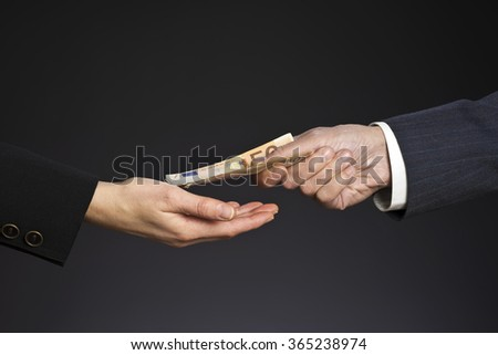 Business people hands and fifty euros banknotes, isolated gray background. Give a money, bribe. Corruption concept. Man and woman hand - stock photo