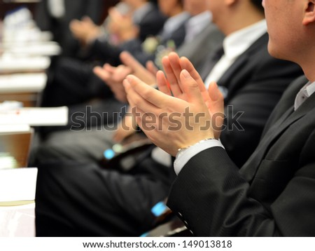 Business people hands applauding at meeting. - stock photo