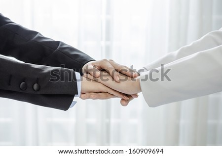 Business people hands on top of each others - stock photo