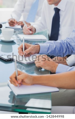 Business people hands taking notes during a meeting