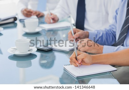 Business people hands taking some notes during a meeting - stock photo