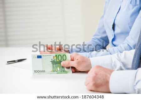 Business people hands with euro banknotes - closeup shot - stock photo
