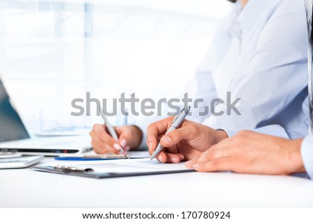 Business people hands writing sign up contract, sitting at desk office write notes. Close up paper signing a business contract, businesspeople holding pens seminar - stock photo