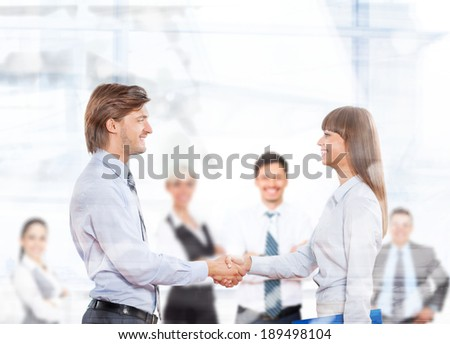 Business people handshake, businessmen smile hand shake businesswoman, sign up contract in modern office, group businesspeople team behind, view throw window