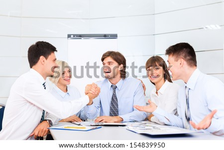 Business people handshake, businessmen smile hand shake, during meeting signing agreement sitting at office  desk, corporate team work group on bank conference