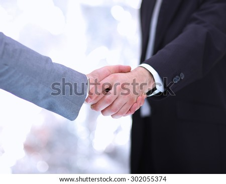 Business people handshake in the office - stock photo