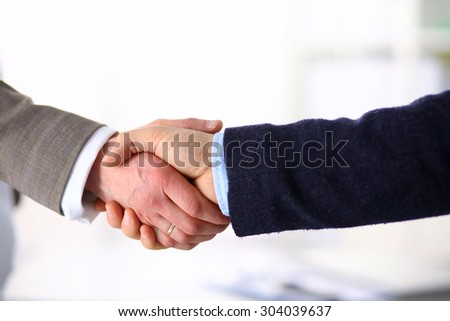 Business people handshake, sitting at the table
