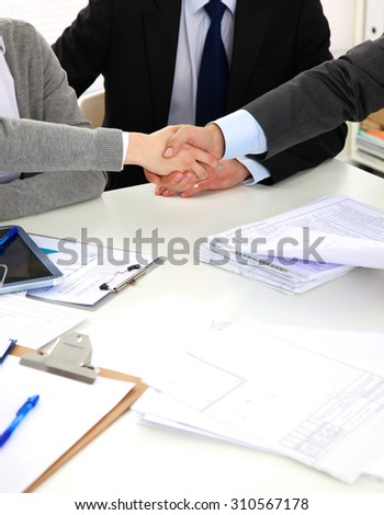 Business people handshake, sitting at the table - stock photo