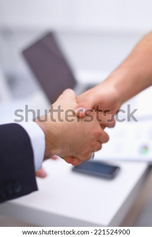 Business people handshake, sitting in the office - stock photo