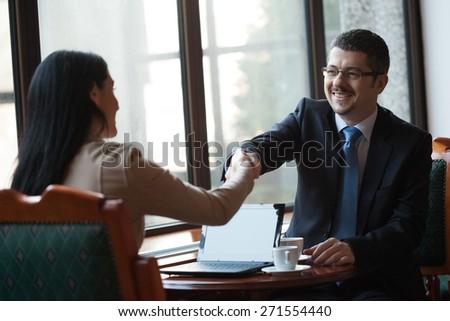 Business people handshaking - stock photo