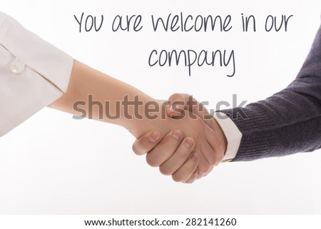 Business people handshaking with the inscription on a white background - stock photo