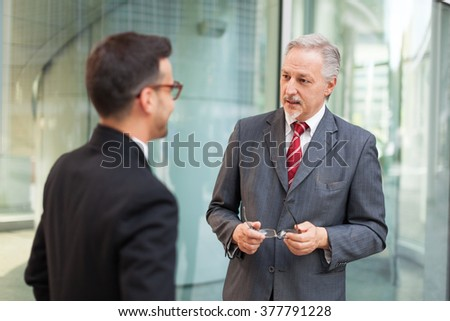 Business people having a conversation - stock photo