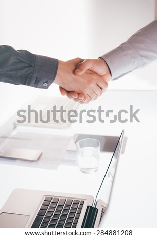 Business people having a meeting and handshaking, hands close up,  cooperation and agreement concept - stock photo