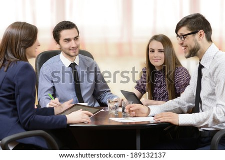 Business people having board meeting at office