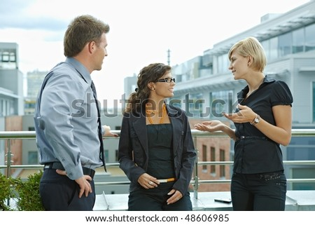 Business people having break and talking on terrace of office building. - stock photo