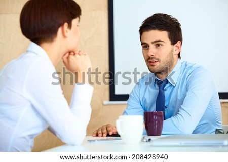 Business People having conversation with colleague during break - stock photo