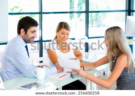 Business people having discussion in office - stock photo