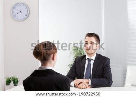 Business people having job interview with young woman