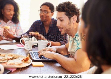 Business People Having Meeting And Eating Pizza - stock photo