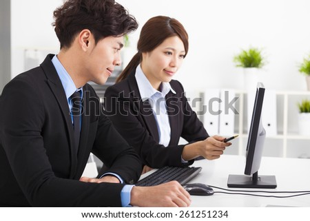 Business people Having Meeting and looking the computer In  Office - stock photo