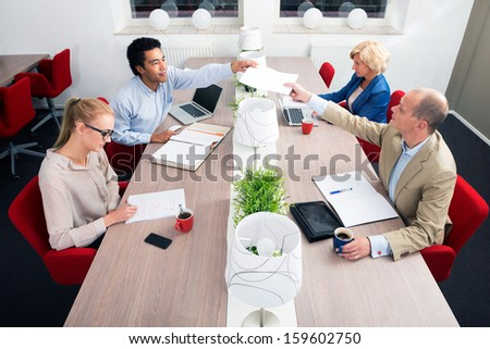 Business people having meeting in an office - stock photo