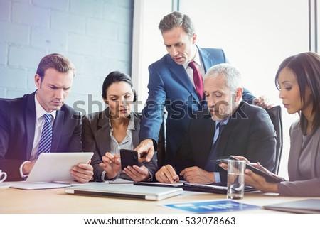 Business people having meeting in conference room at office